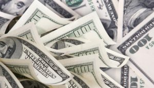 shutterstock_money-100-dollar-bills-940x540